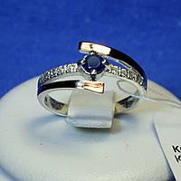 Кольцо серебро с вставками из золота с синим камнем 1250сап з.нак