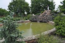 Строительство искусственного пруда 90 м3 с водопадом.