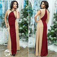 Элегантное вечернее платье прилегающего силуэта, декорированное симметричными вставками по бокам.