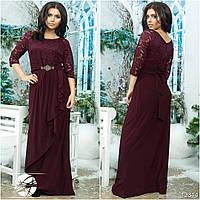 Оригинальное платье с вшивным поясом и оригинальной асимметричной юбкой, декорировано гипюровой вставкой.
