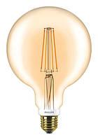 Лампа филаментная Philips LEDClassic 7-60W G120 E27 2000K GOLD APR DIMM.