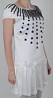 Белое платье с модным декором