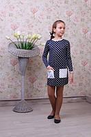 Стильное детское платье в горошек с кармашками