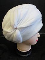 Утепленные шапки из нерпы для женщин.