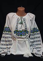 Женская вышиванка с голубой вышивкой