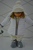 Мальчик в зимней куртке  49см.