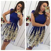 Платье украшенное золотой вышивкой