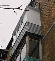 Обшивка балконов сайдингом, фото 1
