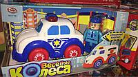 Детская игрушка веселые колеса