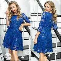 Коктейльное платье синего цвета с рукавом 3/4.