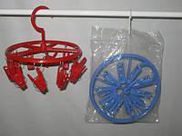 Пластмассовая круглая торговая вертушка с прищепками