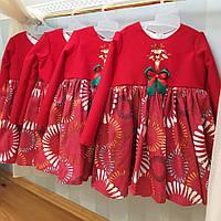 Красное платье с принтом на юбке и бантиком