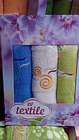 Подарочный набор махровых полотенец тройка цветной