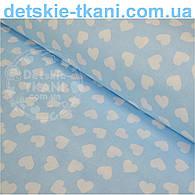 Ткань хлопковая с разносторонними сердечками 15 мм на голубом фоне № 534