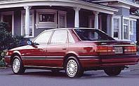 Стекло двери заднее левое Mazda 626 GD СЕДАН