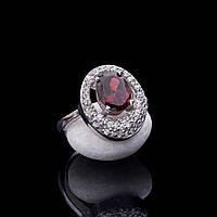 Серебряное кольцо с пиропом (гранатом) и фианитами