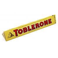 Швейцарский молочный шоколад. Toblerone с медом и миндалем,100 г