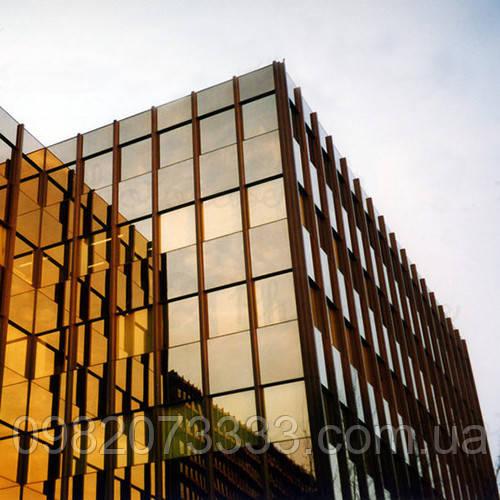 Архитектурное тонирование стёкол зеркальной солнцезащитной плёнкой Sun Control R Gold 15