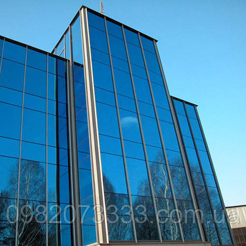 Архитектурное тонирование стёкол зеркальной солнцезащитной плёнкой Sun Control R Blue 15