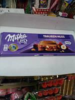 Milka шоколад с орешками большой 300грам