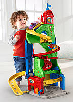 Fisher-Price Little People Трек Небоскреб гоночная трасcа 2 в 1 Sit 'n Stand Skyway