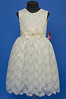 Нарядное детское платье бежевого цвета