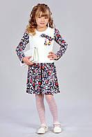Милое красивое платье с помпонами для девочки