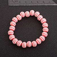 Браслет полосатая бусина на резинке d-10 мм розовый