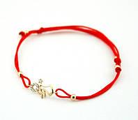 Браслет с красной шёлковой нити с позолоченой подвеской