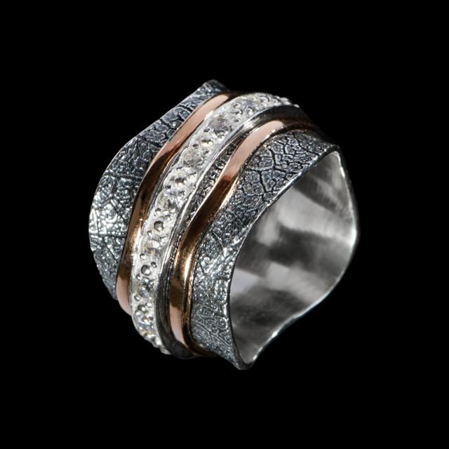 Серебряное кольцо Солярис с золотом и чернением