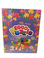 Яйцо пластиковое Eggo Puzzle с Пазлами и конфетами 12 шт
