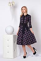 Женское тёплое платье из теплого трикотажа с воротником-стойкой декорированный молнией (длина миди)