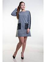 Теплое платье из однотонного трикотажа с карманами