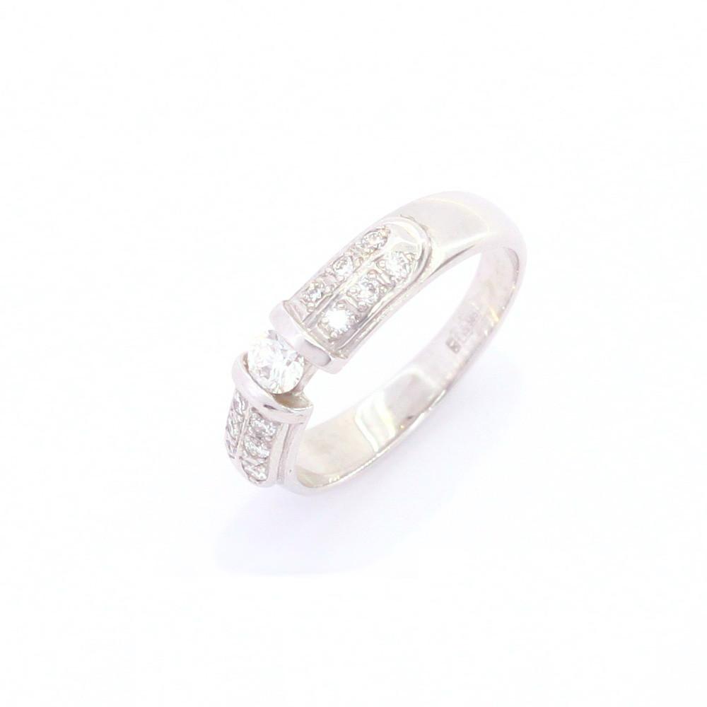 Золоте кільце з діамантами в білому золоті 585 проби