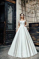 Неповторимое свадебное платье А-силуэта с длинными рукавами и открытой спиной