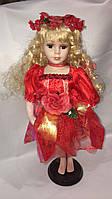 Кукла фарфоровая в красном платице 42 см