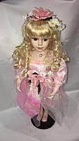 Кукла фарфоровая розовая одежка 42 см