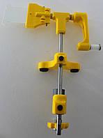 Устройство для намотки нити на шпулю