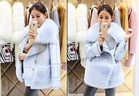 Женское пальто с пышным мехом