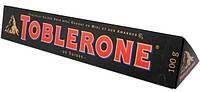 Черный  шоколад Toblerone  c нугой из меда и миндаля , 100 гр