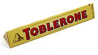 Молочный  шоколад Toblerone  c нугой из меда и миндаля , 100 гр