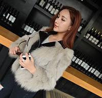 Женская кожаная куртка с меховыми рукавами