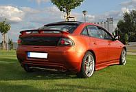 Спойлер тюнинг Mazda 323F