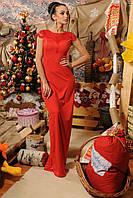 Длинное вечернее платье красного цвета.
