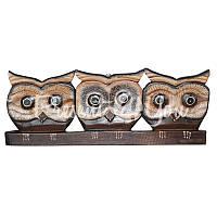 Деревянное панно на стену «Три совы», 48х18 см.
