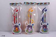Детская игрушка гитара