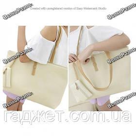 Женская сумка кремово- белого цвета.