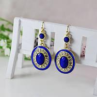Стильные нарядные женские серьги с камнями синего цвета