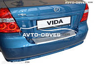 Накладка на бампер с загибом для Chevrolet Aveo II 4D 2006 - 2011 лого Авео