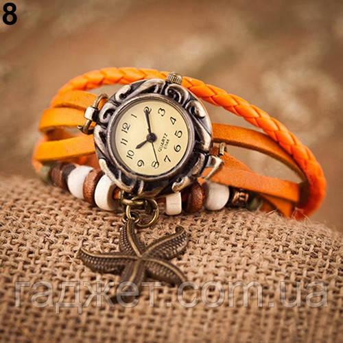 Женские наручные часы браслет с подвеской морская звезда оранжевого цвета.
